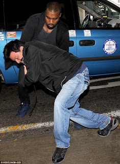 Kanye West assaults paparazzi at LAX
